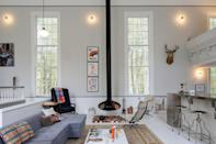 """Much ink has been spilled about the Phillipsport Church House, located on the historic Delaware and Hudson canal between the <a href=""""https://www.cntraveler.com/story/these-inns-are-redefining-the-catskills?mbid=synd_yahoo_rss"""" rel=""""nofollow noopener"""" target=""""_blank"""" data-ylk=""""slk:Catskills"""" class=""""link rapid-noclick-resp"""">Catskills</a> and Shawangunks. The chapel dates back to 1823 but was reimagined as a five-bedroom, two-bath home by architect Matthew Bremer. The sanctuary now includes a sleek chef's kitchen and swanky lounge area centered around a suspended wood-burning fireplace. The decor is a little bit edgy, a little bit churchy: Think modernist clawfoot bathtubs, antique pipe organs, cow skin rugs, and framed pictures of Jesus. Three of the bedrooms are tucked into the old church basement, where luncheons and Sunday school classes were once held, but they're hardly dank; beveled sculptural windows let in a flood of natural light. There's also a queen-size bed in the choir loft and a second sleeping chamber on the ground floor. $560, Airbnb (Starting Price). <a href=""""https://www.airbnb.com/rooms/37211117"""" rel=""""nofollow noopener"""" target=""""_blank"""" data-ylk=""""slk:Get it now!"""" class=""""link rapid-noclick-resp"""">Get it now!</a>"""