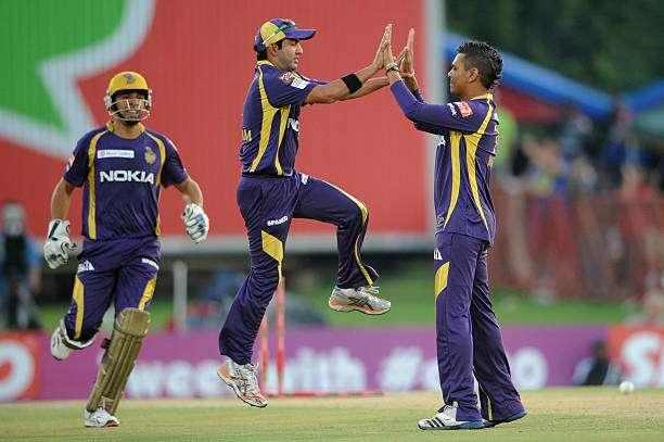 PRETORIA, SOUTH AFRCA - OCTOBER 13: Sunil Narine (R) of the Knight Riders celebrates with Gautam Gambhir after capturing the wicket of Mahela Jayawardene (not pictured) of the Daredevils during the Karbonn Smart CLT20 Group A match between Kolkata Knight Riders (IPL) and Delhi Daredevils (IPL) at SuperSport Park on October 13, 2012 in Pretoria, South Africa. (Photo by Lee Warren/Gallo Images/Getty Images)