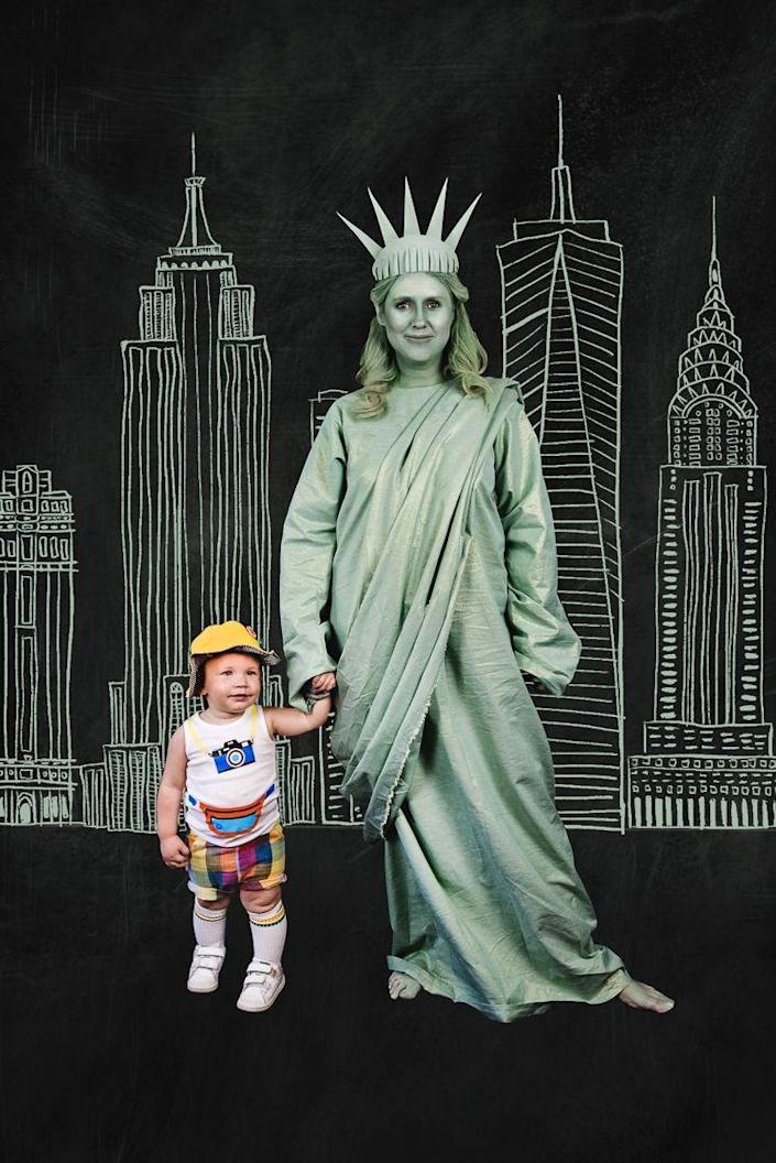 """<p>Show your patriotic pride this Halloween by dressing as Lady Liberty and her loyal tourist. This project works best with a Cricut Maker, but even if you don't have one, the tutorial is full of great inspiration.</p><p><strong>See more at <a href=""""https://thehousethatlarsbuilt.com/2019/09/lady-liberty-and-her-tourist-halloween-costume.html/"""" rel=""""nofollow noopener"""" target=""""_blank"""" data-ylk=""""slk:The House That Lars Built"""" class=""""link rapid-noclick-resp"""">The House That Lars Built</a>. </strong></p><p><a class=""""link rapid-noclick-resp"""" href=""""https://www.amazon.com/Love-NY-Charcoal-Bodysuits-Officially/dp/B0753KFXY8/ref=sr_1_3?tag=syn-yahoo-20&ascsubtag=%5Bartid%7C2164.g.37079496%5Bsrc%7Cyahoo-us"""" rel=""""nofollow noopener"""" target=""""_blank"""" data-ylk=""""slk:SHOP BABY BODYSUITS"""">SHOP BABY BODYSUITS</a></p>"""