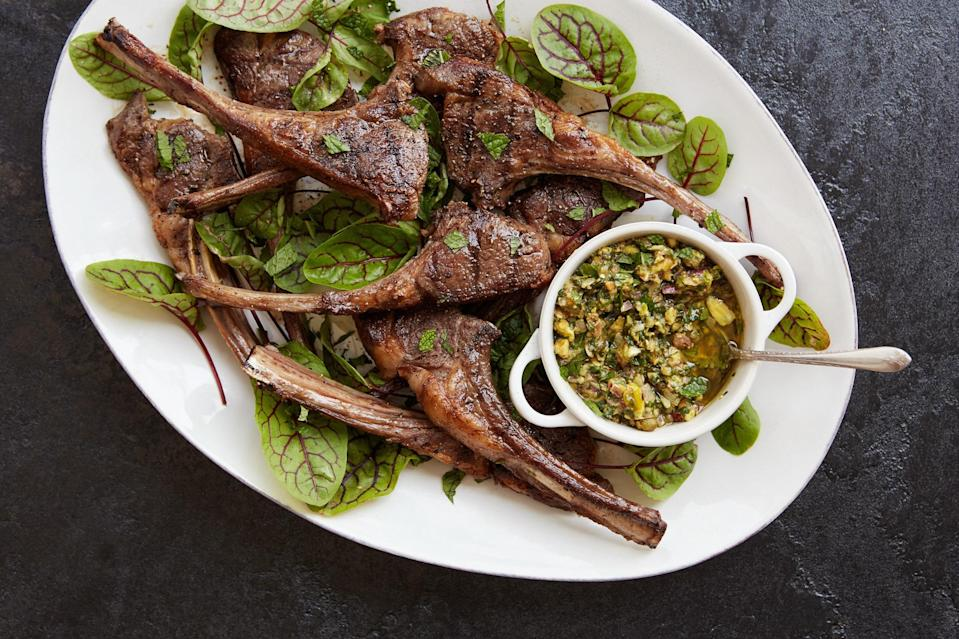 """This recipe was inspired by my dad, Mark Boone, who loves lamb chops and pistachios. In this dish, the nuts add richness to a riff on a classic salsa verde. The bright, herby sauce is the perfect accompaniment to grilled lamb chops. <a href=""""https://www.epicurious.com/recipes/food/views/lamb-chops-with-pistachio-salsa-verde-56389661?mbid=synd_yahoo_rss"""" rel=""""nofollow noopener"""" target=""""_blank"""" data-ylk=""""slk:See recipe."""" class=""""link rapid-noclick-resp"""">See recipe.</a>"""
