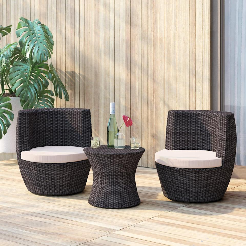 <p>The look of this <span>Landers 3 Piece Bistro Set With Cushions</span> ($610, originally $763) is so unique and fun.</p>