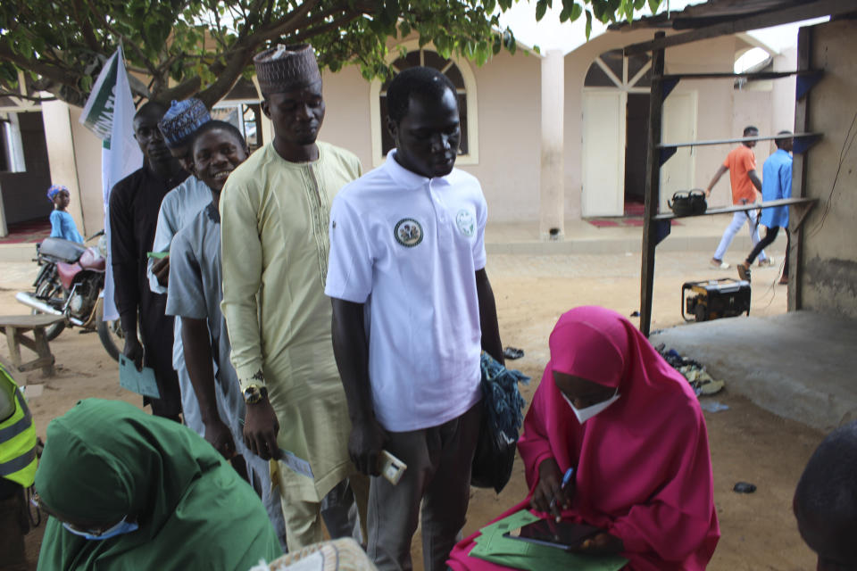 Muslims Faithful wait to register their names before taking a Moderna COVD-19 vaccination outside the Kuje, Central Mosque outskirts of Abuja, Friday, Oct. 8, 2021. Nigeria has begun the second rollout of COVID-19 vaccines as it aims to protect its population of more than 200 million amid an infection surge in a third wave of the pandemic. (AP Photo/Gbemiga Olamikan)