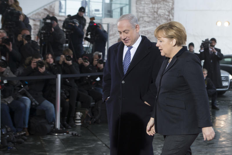 CORRECTS SPELLING OF NETANYAHU  German Chancellor Angela Merkel, right, welcomes the Prime Minister of Israel, Benjamin Netanyahu at the chancellery Berlin, Thursday, Dec. 6, 2012. It was supposed to be an amicable meeting between close friends. Instead, Israeli Prime Minister Benjamin Netanyahu's visit to Germany has been soured by Berlin's refusal to oppose a Palestinian U.N. statehood bid and anger throughout Europe over Israeli plans to expand settlements around Jerusalem. (AP Photo/Markus Schreiber)