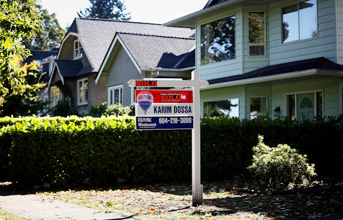 A real estate for sale sign is pictured in front of a home in Vancouver, British Columbia, Canada, September 22, 2016. REUTERS/Ben Nelms