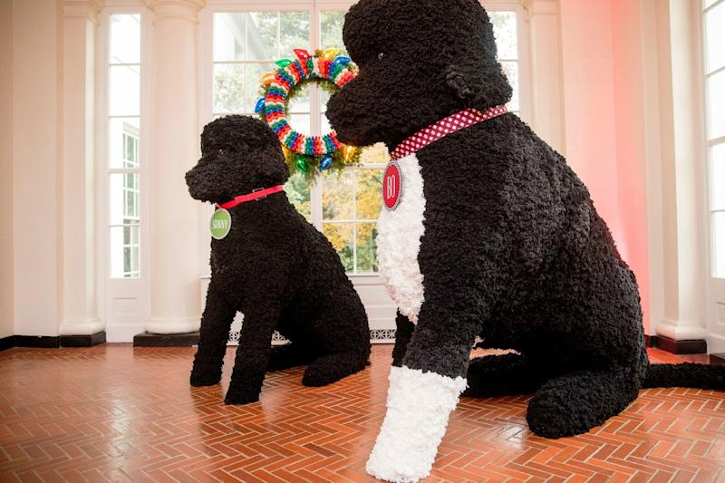 Replicas of Bo and Sunny, made of more than 25,000 yarn pom-poms, are displayed in the East Wing as part of the 2016 holiday decor at the White House.