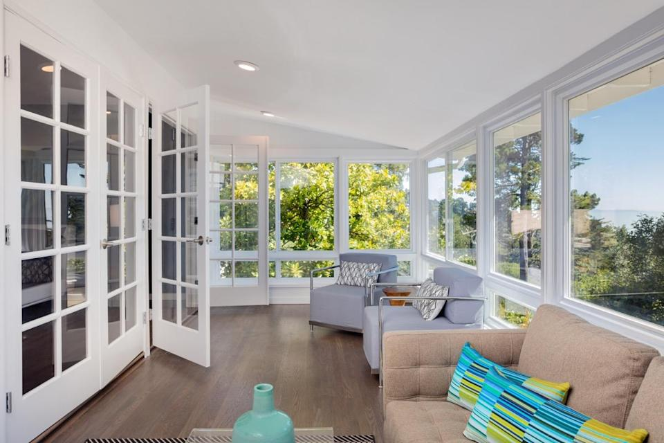 """Does spending a relaxing afternoon reading a book in your sunroom seem like a nice idea? Of course. But you'll only waste money adding one to your existing floor plan. According to <em>Remodeling</em>, the <a href=""""https://www.remodeling.hw.net/cost-vs-value/sunroom-addition"""" rel=""""nofollow noopener"""" target=""""_blank"""" data-ylk=""""slk:average cost of a sunroom addition"""" class=""""link rapid-noclick-resp"""">average cost of a sunroom addition</a> as of 2015 was $75,700, though it added just $36,700 in value to a home. And since sunrooms are frequently unheated, they're only usable for a few months of the year in most climates, which hardly translates to getting bang for your buck."""