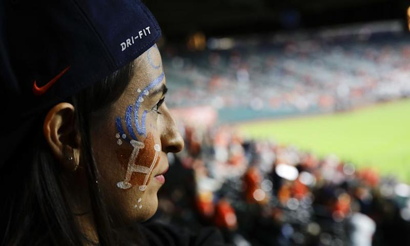 A fan watches batting practice before the game.