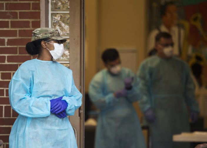 IMAGE: Tennessee National Guard medical staff members (Troy Stolt / Chattanooga Times Free Press via AP)