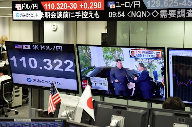 <p>Screens displaying North Korea's leader Kim Jong Un arriving to meet US President Donald Trump in Singapore and the Japanese yen's exchange rate against the US dollar are seen at a foreign exchange trading company in Tokyo on June 12, 2018. (Photo by Kazuhiro Nogi/AFP/Getty Images) </p>