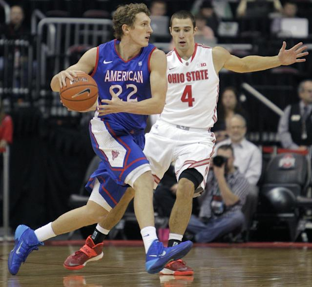 American's John Schoof, left, is guarded by Ohio State's Aaron Craft during the first half of an NCAA college basketball game on Wednesday, Nov. 20, 2013, in Columbus, Ohio. (AP Photo/Jay LaPrete)