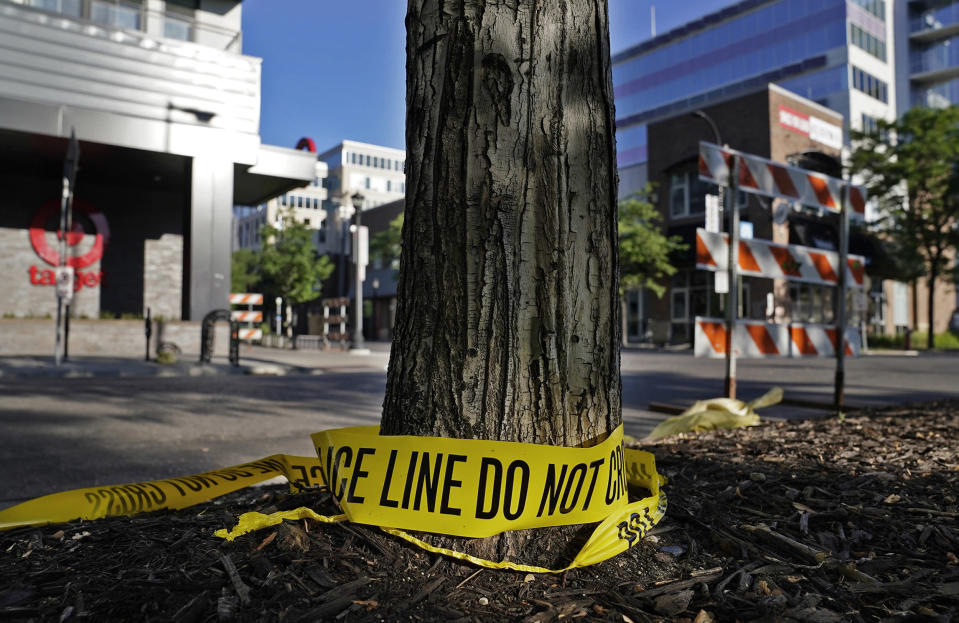 Discarded police tape lays outside a Target, on June 14, 2021, in Uptown Minneapolis. (David Joles / Star Tribune via AP)