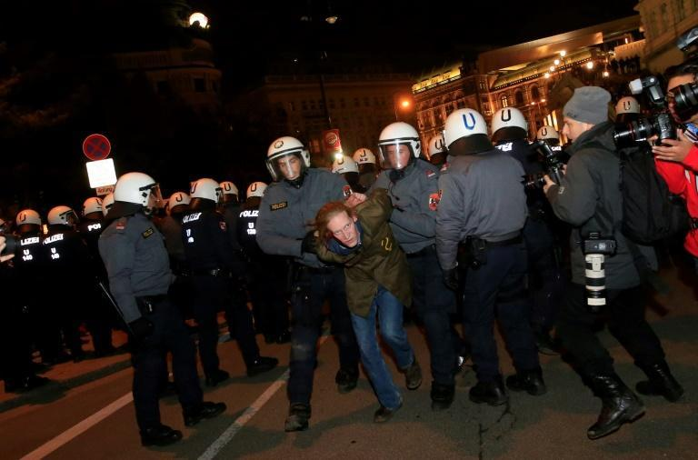 A demonstrator is arrested as he protests against the Wiener Akademikerball, a ball organised by the far-right FPOE