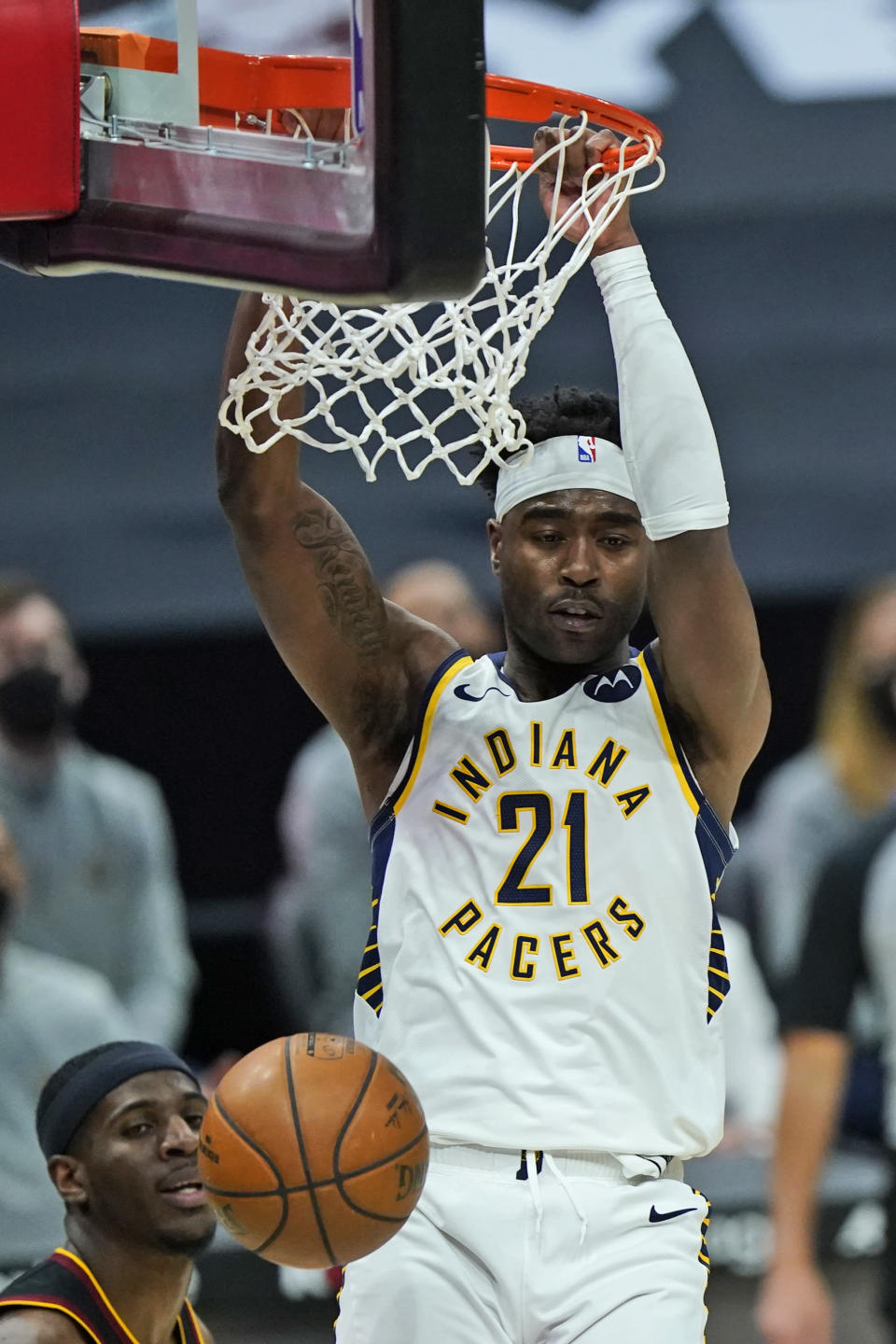 Indiana Pacers' Kelan Martin (21) dunks the ball in the second half of an NBA basketball game against the Cleveland Cavaliers, Monday, May 10, 2021, in Cleveland. (AP Photo/Tony Dejak)