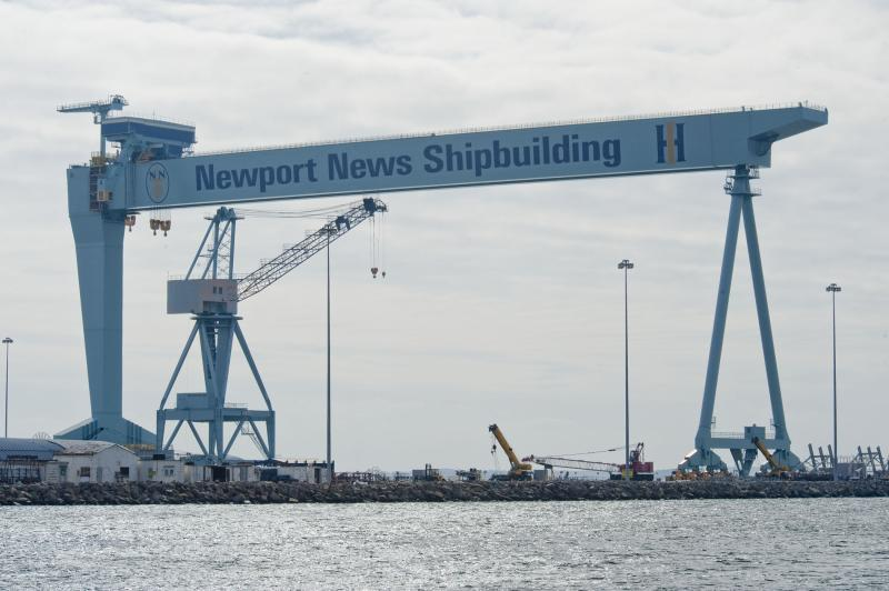 "The iconic ""Big Blue"" crane towering over Newport News shipyard."