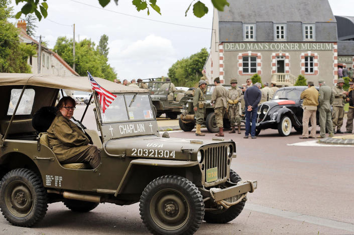 <p>Men dressed with U.S. military uniforms attend commemorations marking the 73th anniversary of D-Day in Hiesville, France, on Tuesday. (Photo: Chesnot/Getty Images) </p>