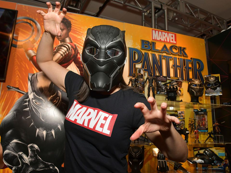 IMAGE DISTRIBUTED FOR HASBRO, INC. - A demonstrator at the Hasbro, Inc. showroom showcases the MARVEL LEGENDS SERIES BLACK PANTHER HELMET, a 1:1 full-scale premium role play electronic helmet at American International Toy Fair on Saturday, Feb. 17, 2018 in New York. (Photo by Charles Sykes/Invision for Hasbro, Inc./AP Images)