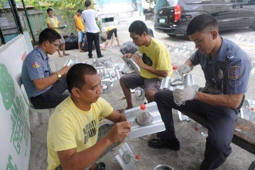 Inmates and jail guards manufacture solar light bottles at a jail in Manila. Illac Diaz said another 100,000 would be installed in Cebu in December, putting the project on track to meet or exceed its goals of helping one million people over 12 months