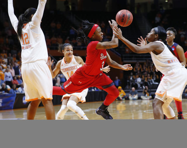 St. John's guard Aliyyah Handford (3) drives between Tennessee defenders Bashaara Graves (12), Andraya Carter (14) and Jordan Reynolds, right, in the second half of an NCAA women's college basketball second-round tournament game Monday, March 24, 2014, in Knoxville, Tenn. (AP Photo/John Bazemore)