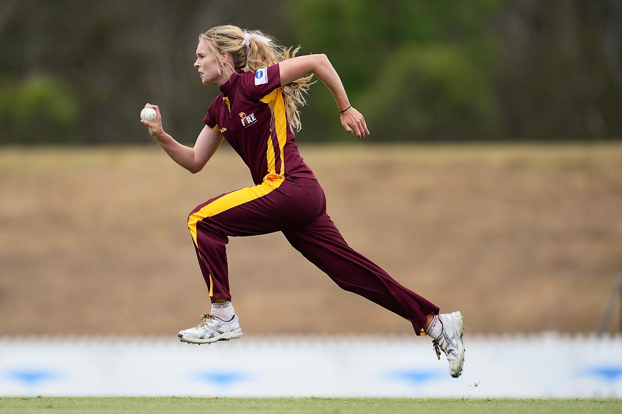 SYDNEY, AUSTRALIA - FEBRUARY 05:  Holly Ferling of Queensland bowls during the WT20 semi final match between Victoria and Queensland at Blacktown International Sportspark on February 5, 2014 in Sydney, Australia.  (Photo by Brett Hemmings/Getty Images)