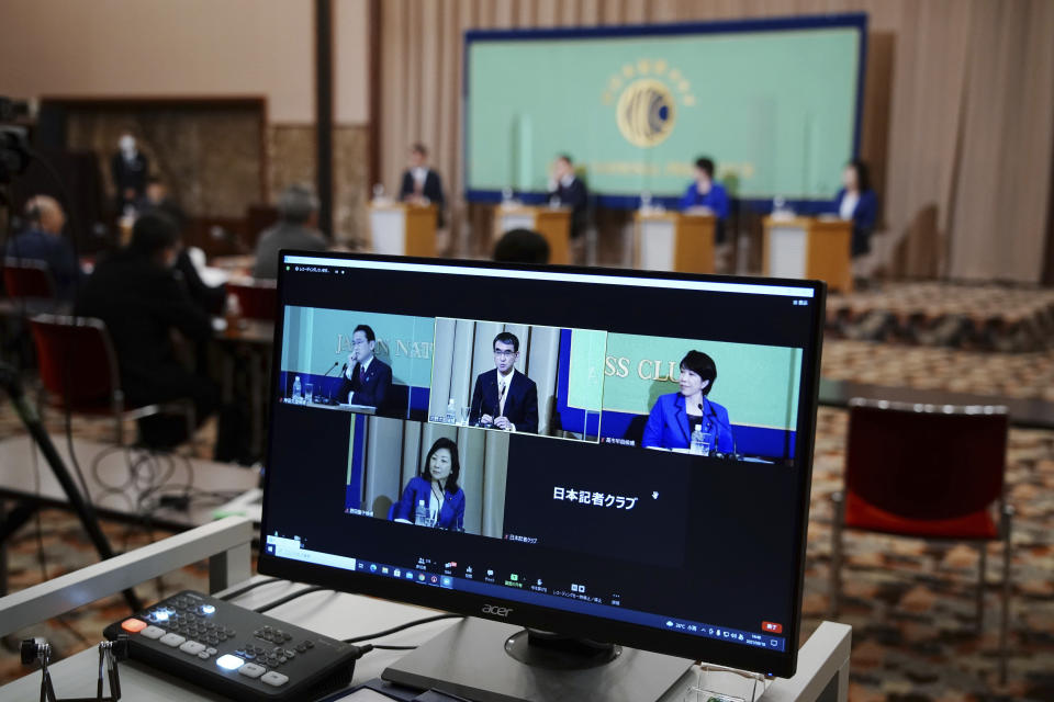 A computer monitor shows the live streaming of the candidates for the presidential election of the ruling Liberal Democratic Party speaking at a debate session hosted by the Japan National Press Club Saturday, Sept. 18, 2021 in Tokyo. The contenders are, from left, Taro Kono, the cabinet minister in charge of vaccinations, Fumio Kishida, former foreign minister, Sanae Takaichi, former internal affairs minister, and Seiko Noda, former internal affairs minister. (AP Photo/Eugene Hoshiko, Pool)