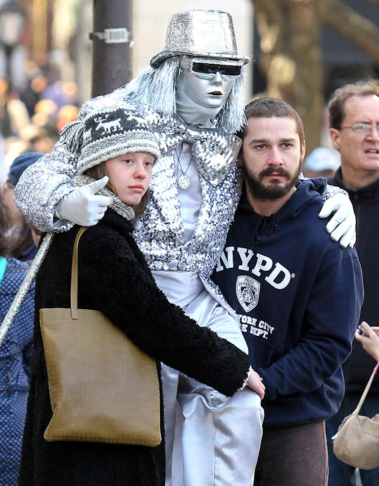 Shia LaBeouf and girlfriend Mia Goth spotted kissing and cuddling after enjoying a romantic day around Central Park, where they have their picture taken with a street artist.