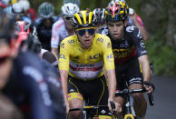 Slovenia's Tadej Pogacar, wearing the overall leader's yellow jersey, and Belgium's Wout Van Aert, right, climb during the eighteenth stage of the Tour de France cycling race over 129.7 kilometers (80.6 miles) with start in Pau and finish in Luz Ardiden, France,Thursday, July 15, 2021. (AP Photo/Christophe Ena)