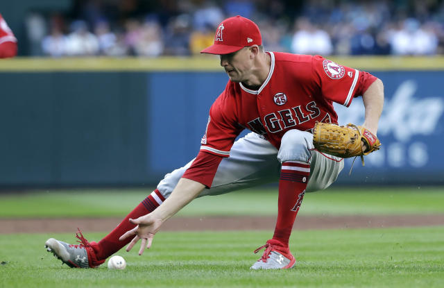 Los Angeles Angels starting pitcher Griffin Canning reaches for a sacrifice bunt from Seattle Mariners' J.P. Crawford in the first inning of a baseball game Saturday, July 20, 2019, in Seattle. Canning made the throw to first for an out on the play. (AP Photo/Elaine Thompson)