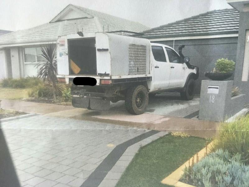 Pictured is a ute parked in a Perth driveway with the tray slightly hanging over the footpath.