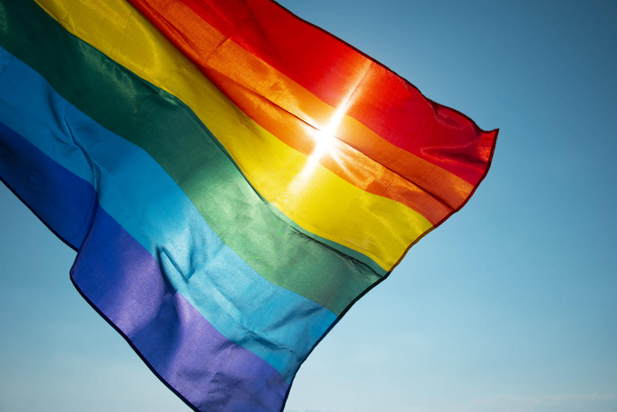 A rainbow flag can indicate a refuge — which is why some are upset that schools and towns across the country are banning them. (Photo: Getty Images)