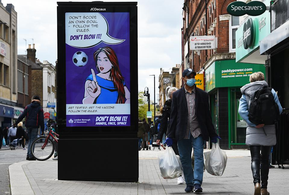 A Covid-19 sign on the high street in Hounslow, west London, one of the areas of the UK where the Covid variant first identified in India is spreading fastest. Picture date: Tuesday May 25, 2021. (Photo by Kirsty O'Connor/PA Images via Getty Images)