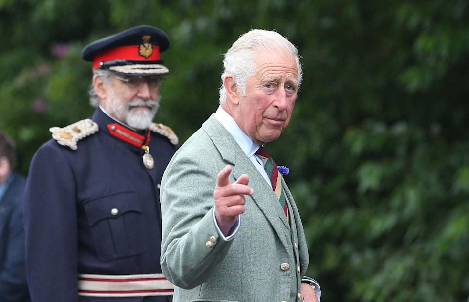 Britain's Prince Charles, Prince of Wales gestures during a visit to the DS McGregor and Partners Veterinary Surgery in Thurso, Caithness on July 29, 2021, as part of a two-day visit to Scotland
