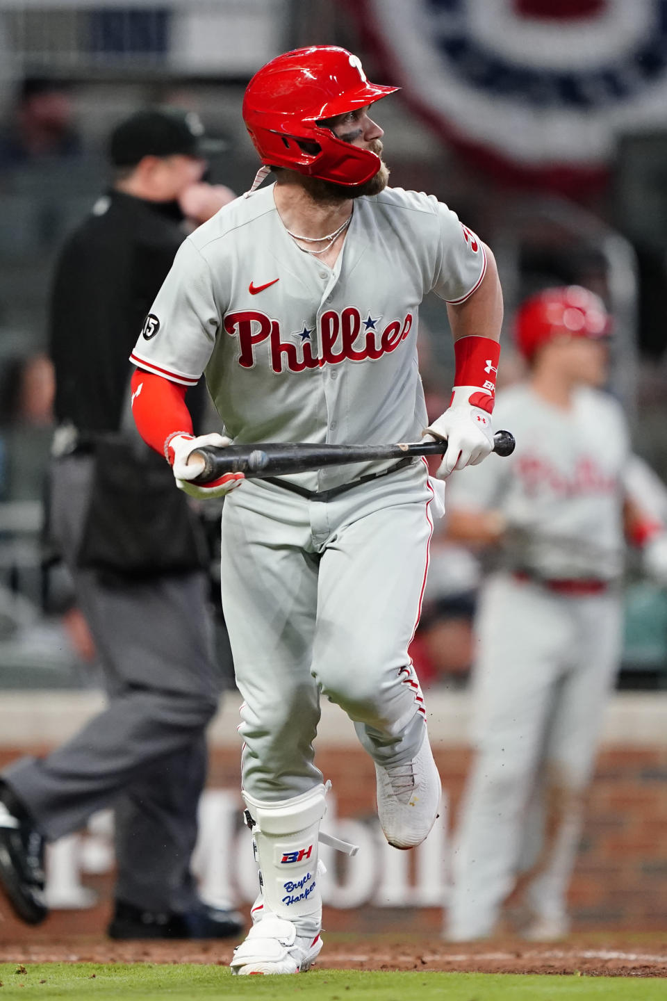 Philadelphia Phillies' Bryce Harper (3) runs to first after hitting a home run in the sixth inning of a baseball game against the Atlanta Braves Sunday, April 11, 2021, in Atlanta. (AP Photo/John Bazemore)