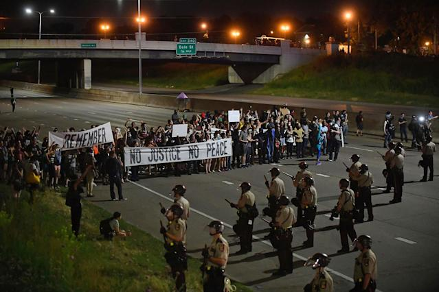 <p>Police and demonstrators stand on Interstate 94 on Friday night, June 16, 2017, in St. Paul, Minn. A Minnesota police officer, Jeronimo Yanez, was cleared Friday in the fatal shooting of Philando Castile, a black motorist whose death captured national attention when his girlfriend streamed the grim aftermath on Facebook (Aaron Lavinsky/Star Tribune via AP) </p>