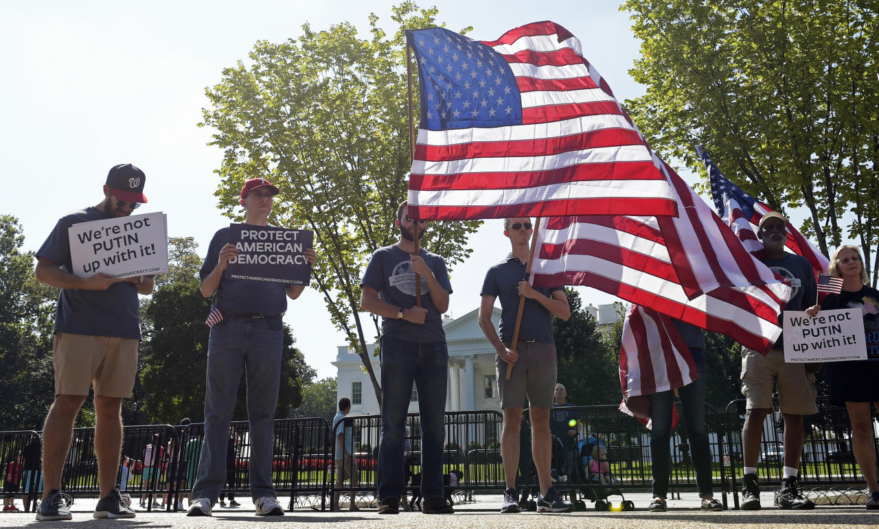 <p>Protesters gather outside the White House in Washington, Saturday, Sept. 16, 2017, during a rally encouraging President Donald Trump and House Speaker Paul Ryan to defend American democracy from Russian interference. (Photo: Susan Walsh/AP) </p>