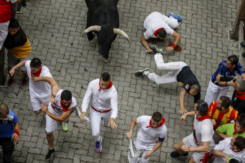 Revellers run with Puerto de San Lorenzo's fighting bulls before entering the bullring during the second day of the San Fermin Running of the Bulls festival on July 7, 2019 in Pamplona, Spain. (Photo: Pablo Blazquez Dominguez/Getty Images)