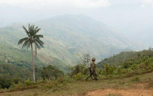 "A Colombian soldier patrols in the department of Cauca, a known stronghold of the FARC rebels, in July 2012. Colombian President Juan Manuel Santos confirmed that his government had begun ""exploratory discussions"" with leftist FARC rebels to lay the groundwork for a full-fledged peace process"