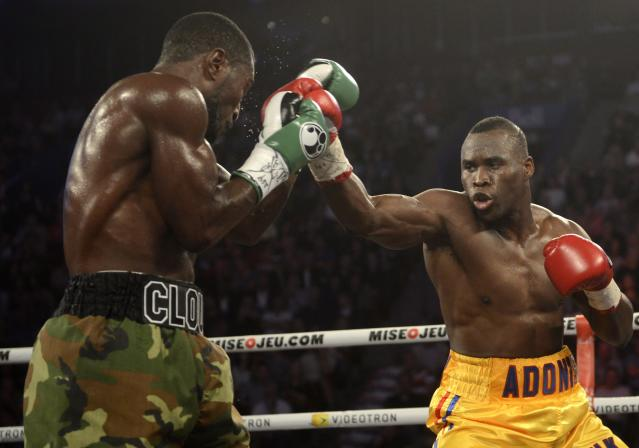 Adonis Stevenson, right, from Montreal, and Tavoris Cloud, of the Unite Statess, battle during boxing bout Saturday, Sept. 28, 2013, in Montreal. (AP Photo/The Canadian Press, Ryan Remiorz)