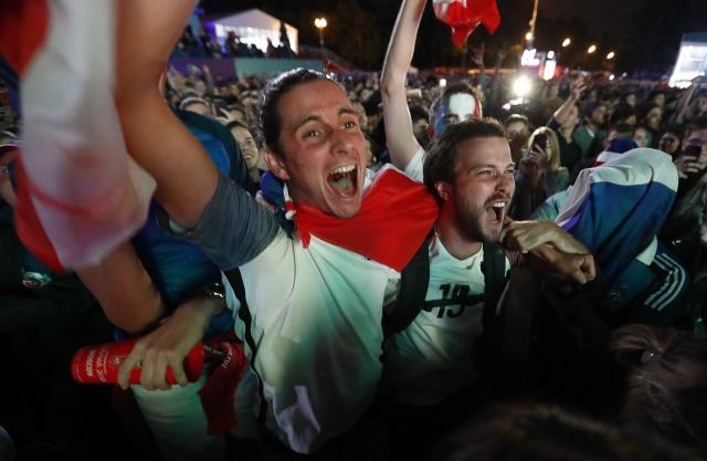 <p>Supporters of France celebrate the victory as they watch the match in a fan zone. REUTERS/Sergei Karpukhin </p>
