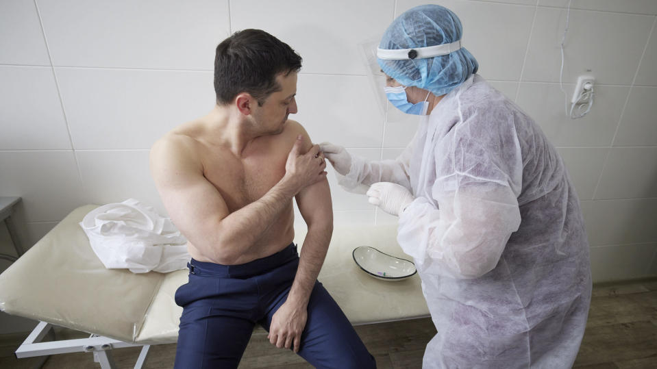 In this handout photo provided by the Ukrainian Presidential Press Office, Ukrainian President Volodymyr Zelensky receives a dose of the AstraZeneca vaccine, marketed under the name CoviShield, as he visits the war-hit Luhansk region, eastern Ukraine, Tuesday, March 2, 2021. (Ukrainian Presidential Press Office via AP)