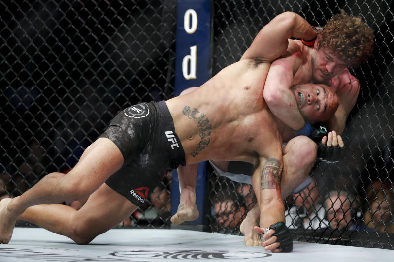 Ben Askren chokes Robbie Lawler in a welterweight mixed martial arts bout at UFC 235, Saturday, March 2, 2019, in Las Vegas. (AP Photo/John Locher)