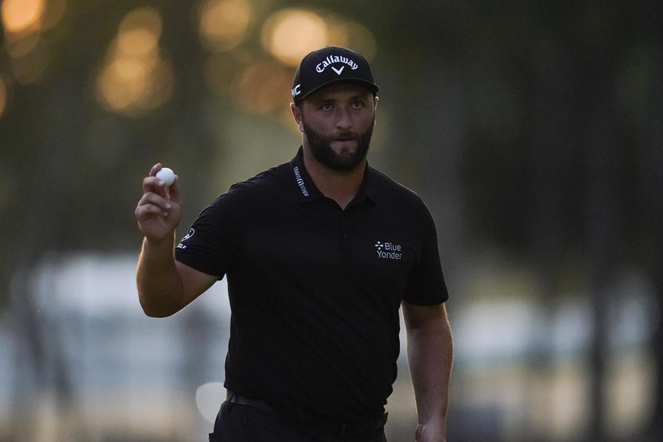 Jon Rahm, of Spain, reacts after sinking his putt on the 15th green during the second round of the BMW Championship golf tournament, Friday, Aug. 27, 2021, at Caves Valley Golf Club in Owings Mills, Md. (AP Photo/Julio Cortez)