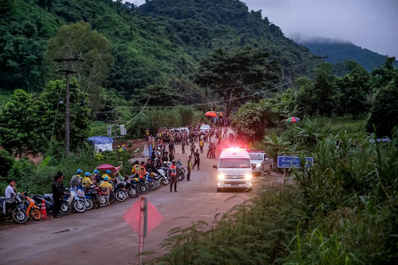 An ambulance carrying one of the soccer players rescued from Tham Luang Nang Non cave in Thailand heads to a hospital on July 8. All 12 boys and their coach were extricated from the cave by July 10. (Linh Pham / Getty Images)