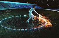 <p>A dramatic display of fire and water was performed by Australian sprinter Cathy Freeman at the 2000 Summer Olympic Games opening ceremony. The elaborate lighting of the Olympic torch was to symbolize the first Olympic Games in the new millennium. </p>