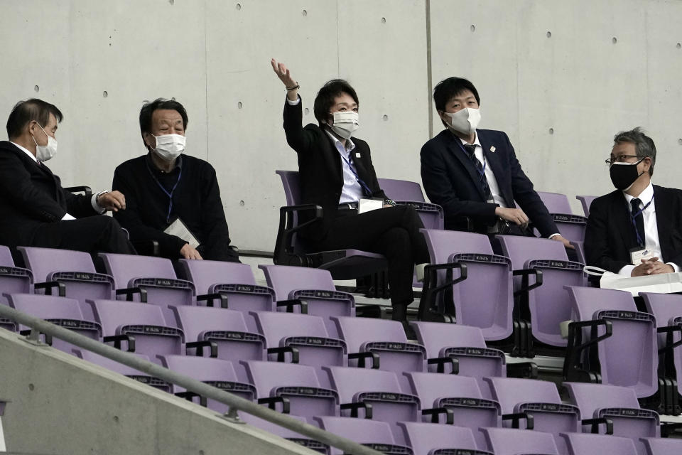 Tokyo 2020 Organizing Committee President Seiko Hashimoto, center gestures as she observes Japan women's national team candidates staging a match in the operational test event of Rugby in preparation for the Tokyo 2020 Olympic Games at Tokyo Stadium Thursday, April 22, 2021, in Tokyo. (AP Photo/Eugene Hoshiko)