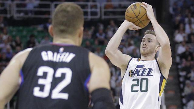 """<a class=""""link rapid-noclick-resp"""" href=""""/nba/players/4561/"""" data-ylk=""""slk:Blake Griffin"""">Blake Griffin</a> prepares for <a class=""""link rapid-noclick-resp"""" href=""""/nba/players/4724/"""" data-ylk=""""slk:Gordon Hayward"""">Gordon Hayward</a> to shoot his shot. (AP)"""
