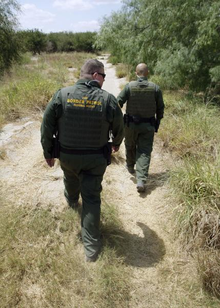 File - In this June 8, 2011, file photo, U.S. Customs and Border Patrol agents patrol along the Rio Grande near Penitas, Texas. An unprecedented surge of children caught trudging through South Texas scrublands or crossing at border ports of entry without their parents has sent government and nonprofit agencies that handle their shelter, legal representation and reunifications scrambling to expand their services. (AP Photo/Eric Gay, File)