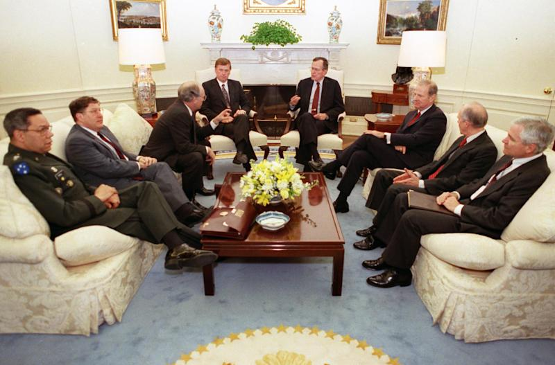 FILE - In this Feb. 25, 1991 file photo taken by an Associated Press photographer, President George H.W. Bush meets in the Oval Office of the White House to receive a national security briefing. As of Thursday, Nov, 21, 2013, White House-based photographers have not been permitted to make a picture of President Barack Obama meeting with his staff in the Oval Office. (AP Photo/Doug Mills, File)