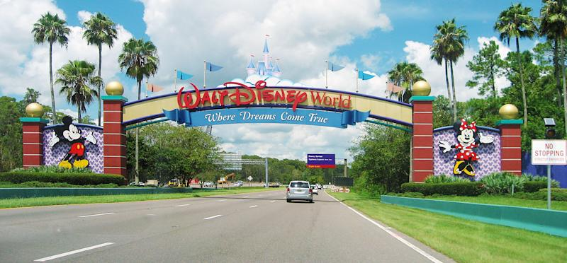 Lake Buena Vista, Florida, USA - August 19, 2015: an entrance of Walt Disney World Resort. Some cars are visible.