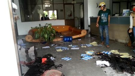 A mob walks through a damaged office of a factory during an anti-China protest in Vietnam's southern Binh Duong province, in this May 13, 2014 picture provided by Tuan Khanh on May 17, 2014. REUTERS/Tuan Khanh/Handout via Reuters