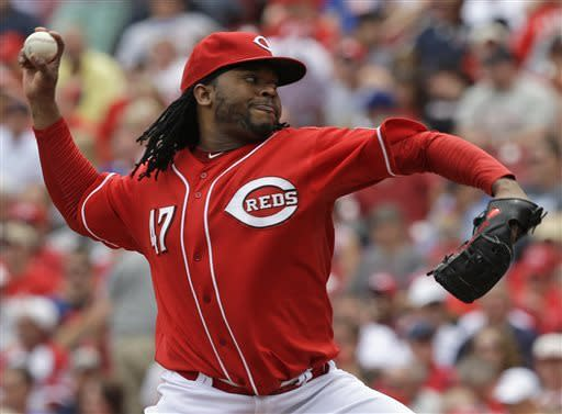 Cincinnati Reds starting pitcher Johnny Cueto throws against the Chicago Cubs in the fifth inning of a baseball game on Sunday, May 26, 2013, in Cincinnati. (AP Photo/Al Behrman)